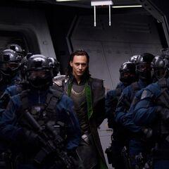 Loki escorted by S.H.I.E.L.D.