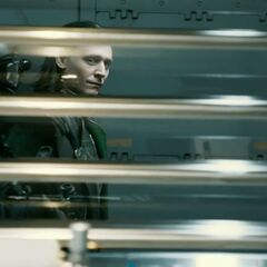 Loki smugly staring at Dr. Bruce Banner as he is taken into custody.