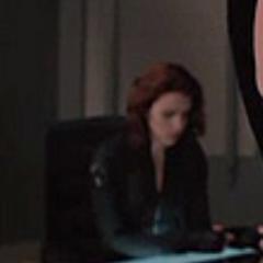 Natasha at the Avengers meeting.