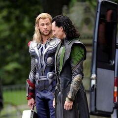Chris Hemsworth as Thor and Tom Hiddleston as Loki on set.