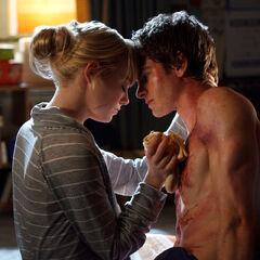 Gwen tending to Peter after a battle.