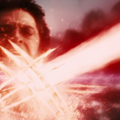 Logan blocks Deadpools laser blast with his claws