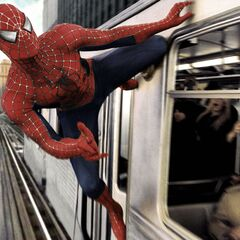 Spider-Man sticks to the side of the train.