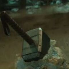 Mjölnir in a Sword in the Stone like placement.