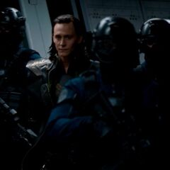 Loki being taken as a prisoner.