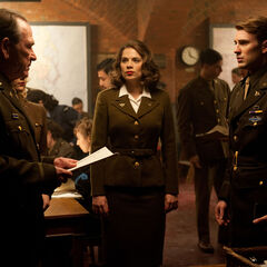 Rogers and Peggy get their orders from Col. Phillips.