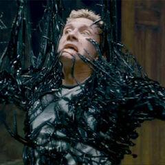 Venom attacks Eddie Brock.