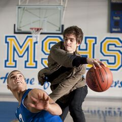 Chris Zylka as Flash Thompson and Andrew Garfield as Peter Parker.