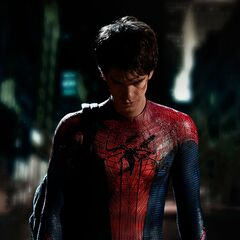Andrew Garfield as Peter Parker in costume without the mask.