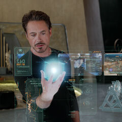 Stark reviewing the data for the cosmic cube.