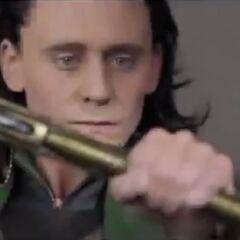 Loki holding his Staff.