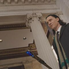 Loki in human clothes.