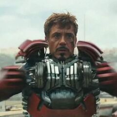 Tony donning the emergency briefcase armor to combat Whiplash