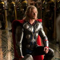 Thor kneels before Odin.