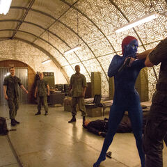 Alex Summers staring as Mystique fights his comrades.