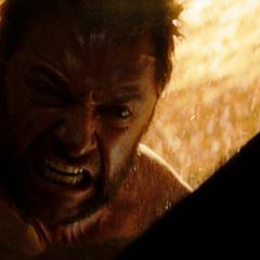 Logan shields Yashida from the heat of the atomic bomb blast