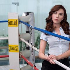 Natasha (as Natalie Rushman) about to take down Happy Hogan.