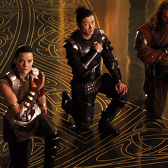 Sif and the Warriors Three kneel before Loki.