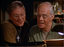 Ep 10x3 - Mulcahy looking over Potter's family album