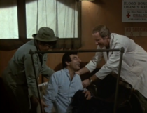 Ep 10x10- Feverish Klinger getting treated by BJ and Nurse Kellye