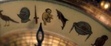 Символы алетиометра Ребенок птица шлем меч дельфин глобус сова фильм