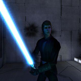 Luke empuñando su sable láser.
