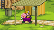 Wario grabbing the Gooey bomb