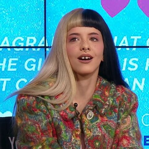 Melanie Martinez talking at the Cry Baby Perfume Milk Live Event