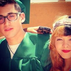 Melanie Martinez with someone who is graduating.