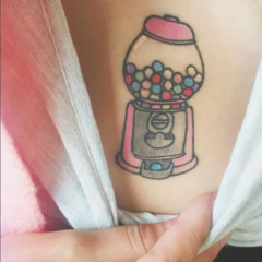Melanie Martinez got this tattoo of a pink gumball machine on the center of chest from her favorite artist Lauren Winzer in January 2016.  She knew that she wanted to get a gumball machine, but deliberated a lot about the placement. Rihanna's goddess Isis tattoo inspired her to want a tattoo in the lower chest area, which she had previously written off as uncool. In an interview with Fuse before getting it done, she explained:  I want to get a gumball machine. I'm still debating where. I think it's cool — and I didn't think it was cool for a long time — but I really want to get a tattoo here [pointing to her abdomen]. It's really hardcore and I know it's hardcore.  I'm not like Rihanna, you know?  I don't know if I could pull that off. I'm hardly ever showing this area of my body. But I don't know, I feel like I'm growing up and I'm going to turn 21 soon, and I might as well do something fun and — I don't know. I might get a gumball machine here. We'll see.