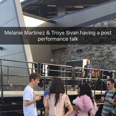 Troye and Melanie talking