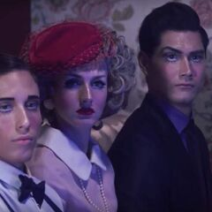 Brother with Mom and Dad in the <i>Dollhouse</i> music video.