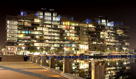 800px-Victoria Harbour Offices at Night