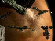 Klingonische Raumschiffe und Stationen im Orbit von Ty'Gokor