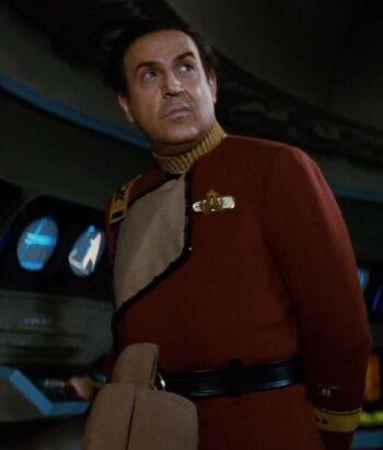 "Commander <i>Beach</i>, a <a href=""/wiki/Human"" title=""Human"">Human</a> male"