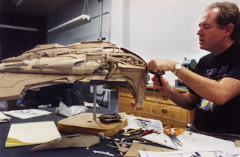 """David Stipes working on the modification of the <a href=""""/wiki/VOY_studio_models#Kazon_fighter"""" title=""""VOY studio models"""">Kazon fighter/raider model</a>"""