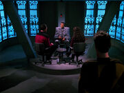 Riker and Troi interrogate Jarok