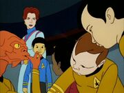 Sarah April and young Spock overlook the infantile Arex, Uhura, Kirk and Sulu