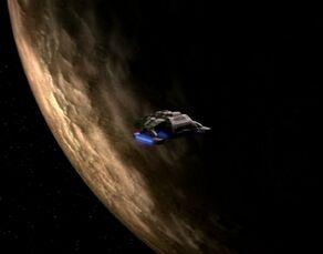 Runabout in orbit of barren moon-Ajilon Prime-Teplan homeworld-Koralis III.jpg