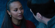 Uhura smiling at Spock