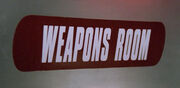 Weapons room sign