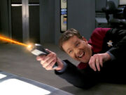 Tom Paris fires phaser