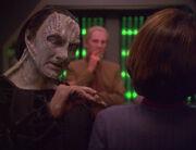 Elim Garak adjusting Kira's Starfleet uniform