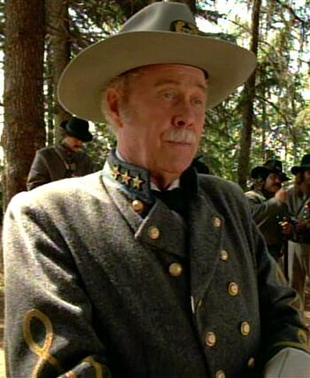 "Harve Presnell as ""Colonel"" Q (1996)"