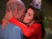 Vash distracts Picard with a kiss