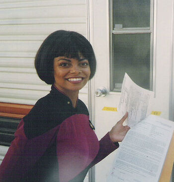 Joyce Robinson in front of her trailer