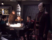 Dax, Odo, O'Brien, Sisko, and Garak in the wardroom