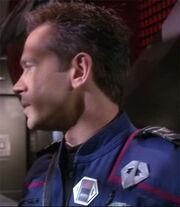 Tucker wearing a radiation meter