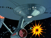 USS Enterprise nearly misses an exploding asteroid