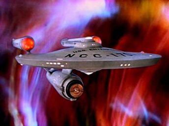 400px-USS Enterprise (NCC-1701) at galactic barrier